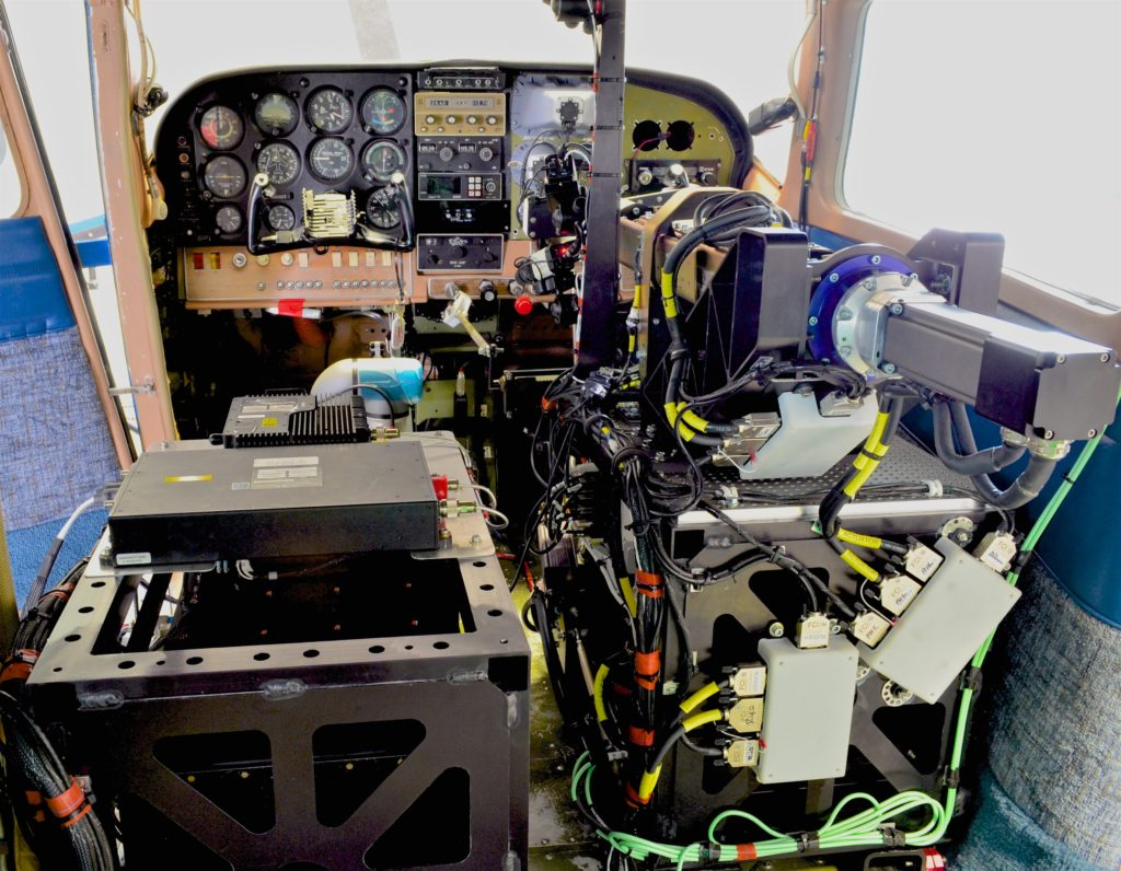 Rear view of the installed ROBOpilot system during preflight for first flight.