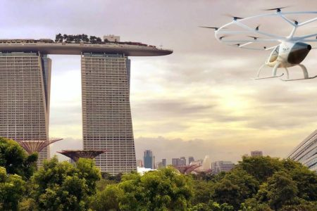 An artist's impression of a Volocopter taxi flying near Marina Bay Sands.