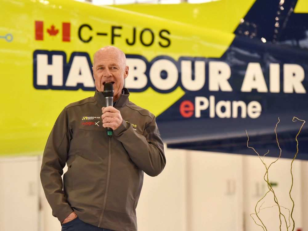 Harbour Air pilot and CEO, , speaks to the crowd who witnessed the first flight of the company's all-electric DHC-2